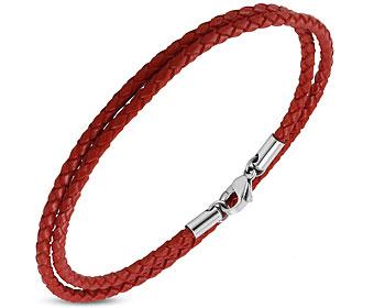 Flätat armband i läder och stål. Längd cirka 40 cm.