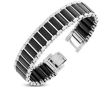 Brett armband. Bredd cirka 18 mm. Längd cirka 20,5 cm.