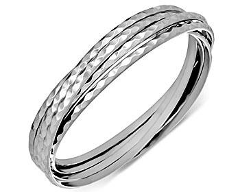 Stelt armband i stål. Armbandet består av 6 stycken ihopsatta armband med respektive bredd på cirka 3 mm. Omkrets cirka 21 cm.