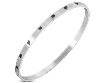 Stelt bangle armband. Omkrets cirka 20 cm, bredd cirka 4 mm.