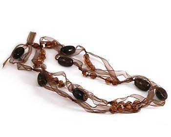 Långt halsband i organzamaterial.
