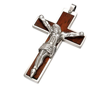 Kors till kedja. Korset är gjort i kirurgiskt stål.