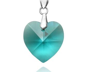 Swarovski hänge i form av ett hjärta. Silver. Storlek ca 1,5cm.