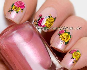 Nageldekaler med gula och röda rosor.