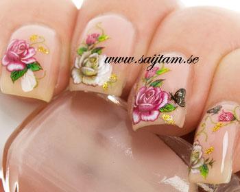 Blomdekaler till naglar med rosor i röda och beigea färger.