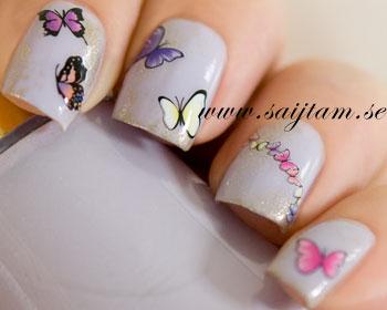 Snygga nageldekaler med fjärilar i rosa/lilafärgade toner. Dekalkartan är ca 12,5x5,5 cm stor.