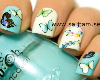 Nageldekaler med blå/gröntonade fjärilar. Kartan är ca 12,5x5,5 cm stor.