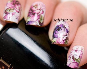 Nageldekaler med röda och lila rosor.