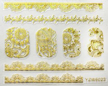 Guldfärgade nageldekaler till nailart.