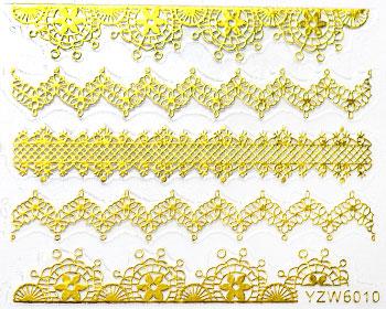 Guldfärgade stickers för naglarna. Dessa är självhäftande och används över nagellack. Manikyren avslutas med topplack.