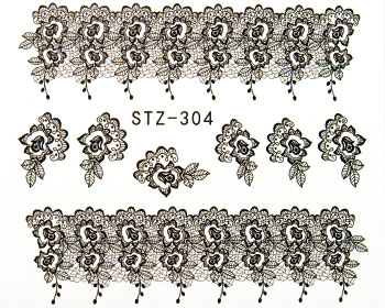 Nageldekaler med svarta mönster.