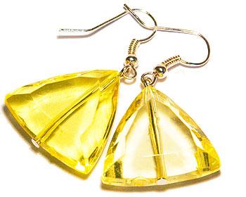Billiga gula örhängen. Längd cirka 4 cm.