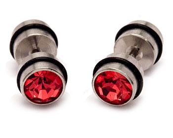 Röda örhängen i stål. Diameter cirka 8 mm.
