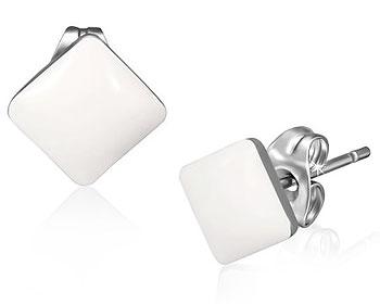 Vita örhängen i stål.
