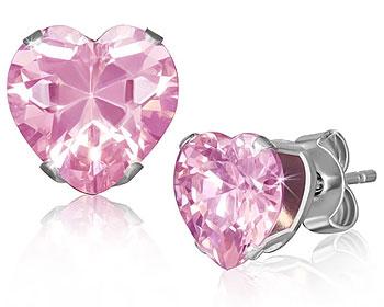 Örhängen med rosa hjärta.