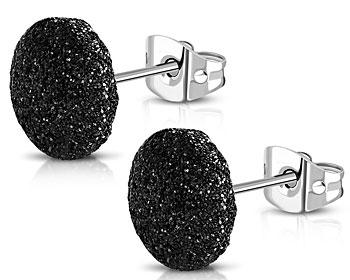 Svarta glittriga örhängen med diametern cirka 11 mm.
