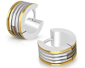 Fina örhängen i stål. Bredd cirka 7 mm, diameter cirka 13 mm.