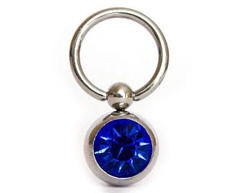 Smycke till piercing. Diameter cirka 8 mm, tjocklek cirka 1,2 mm.